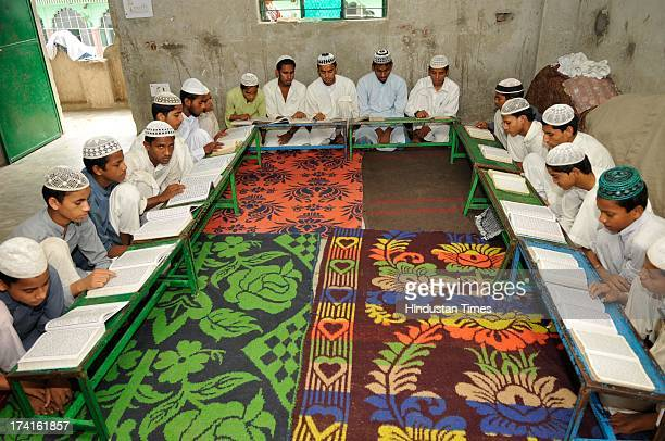 Muslim children reciting verses from Islam's holy book Quran on the 13th day of Ramadan at a Madrasa on July 21, 2013 in Noida, India. Islam's holy...