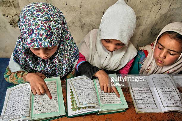 Muslim children study the Quran at a Madrassa in a small village near the town of Kargil in Ladakh Jammu and Kashmir India on June 25 2014