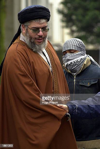 Muslim Cleric Abu Hamza AlMasri is embraced by one of his supporters outside the Finsbury Park Mosque during Friday prayers March 21 2003 in London...