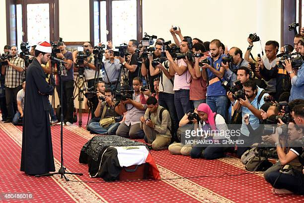 A Muslim cleric prays over the coffin of Cinema legend Omar Sharif during his funeral at Mushir Tantawi mosque in the capital Cairo on July 12 2015...