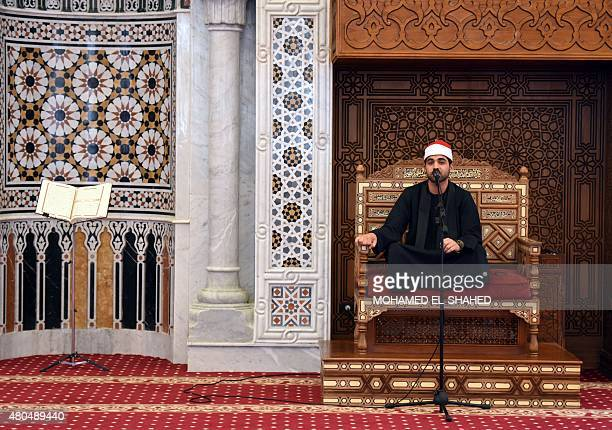 A Muslim cleric recites Koranic verses during the funeral of Cinema legend Omar Sharif at Mushir Tantawi mosque in the capital Cairo on July 12 2015...