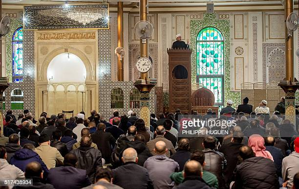 A Muslim cleric speaks ahead of Friday Prayers at the Grand Mosque in Brussels on Match 25 as Muslims gathered for the first Friday prayers in the...