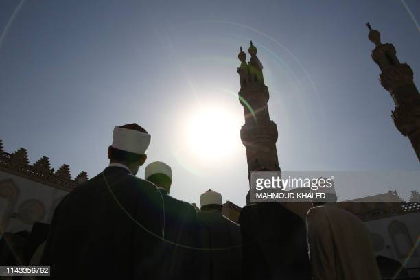 Muslim clerics gather before breaking their fast at the AlAzhar mosque on May 12 as they mark the 1079th anniversary of the establishment of the...