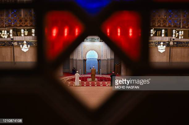 TOPSHOT Muslim clerics practice social distancing while reciting terawih evening prayer at the National Mosque on the first day of the Muslim holy...