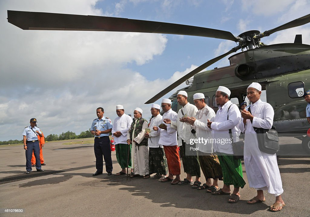 Muslim clerics pray before embarking on a flight with Indonesian Air Force NAS 332 Super Puma helicopter to fly over the Java Sea where AirAsia Flight QZ 8501 went down and pray for the victims, at Iskandar Airport in Pangkalan Bun on January 6, 2015 in Surabaya, Indonesia. A massive recovery operation is underway in waters off Borneo to recover bodies and debris from the missing AirAsia plane. AirAsia announced that flight QZ8501 from Surabaya to Singapore, with 162 people on board, lost contact with air traffic control at 07:24 a.m. local time on December 28.