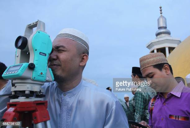 Muslim clerics seen scanning the horizon for crescent moon that will determine the beginning of the holy fasting month of Ramadan at a mosque on May...