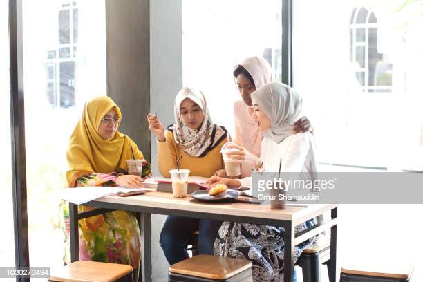 Muslim college students in hijab during a group study
