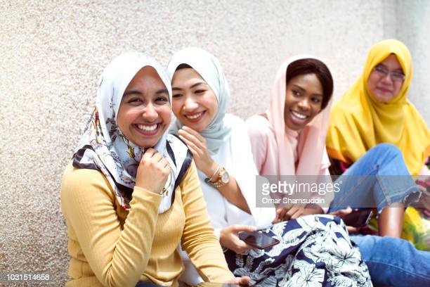 Muslim college students in hijab having a great time