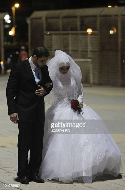 A Muslim couple arrive at a group wedding ceremony organised by the LebanesePalestinian Committee for Development headed by the Lebanese MP Bahiya...