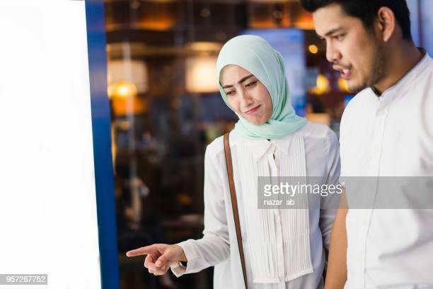 Muslim couple window shopping.