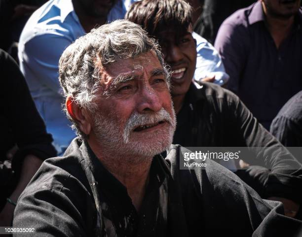 A Muslim cries as he is praying during the annual commemoration Ashura in Pireaus 20 September 2018 Hundreds of Shiite Muslims gathered in Piraeus to...