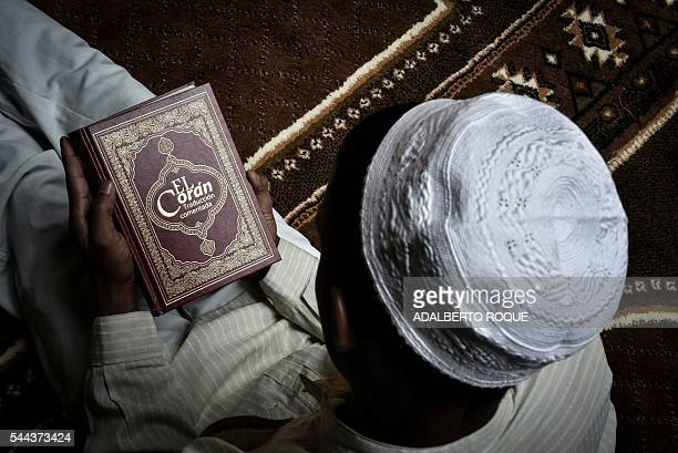 A Muslim Cuban man reads the Koran at the Abdallah mosque during Ramadan in Havana on July 1 2016 The small Muslim community of Cuba celebrates...