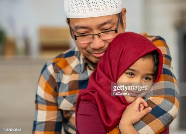 Muslim dad and daughter