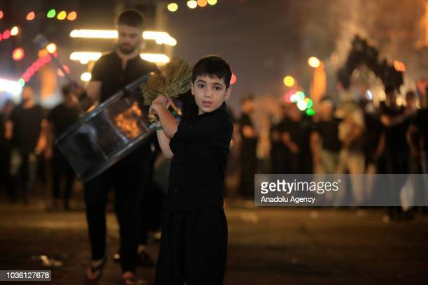 Muslim devotee kid flagellates himself with chains during the holy month of Muharram commemorations in Baghdad Iraq on September 19 2018 Ashure or...