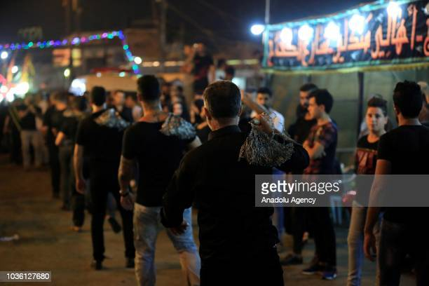 Muslim devotee men flagellate themselves with chains during the holy month of Muharram commemorations in Baghdad Iraq on September 19 2018 Ashure or...