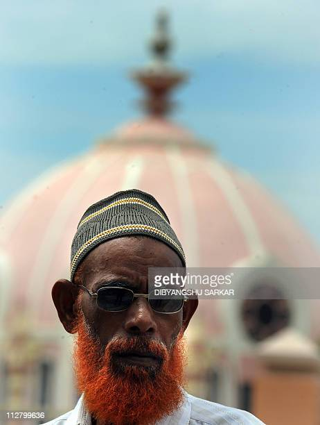 A Muslim devotee waits for news outside The Sri Satya Sai Institute of Higher Medical Science where Indian spiritual leader Satya Sai Baba is under...