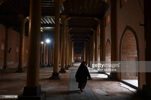 Muslim devotee walks inside Jamia Masjid before Friday prayers in Srinagar on December 20 for the first time in nearly 5 months after Jammu and...