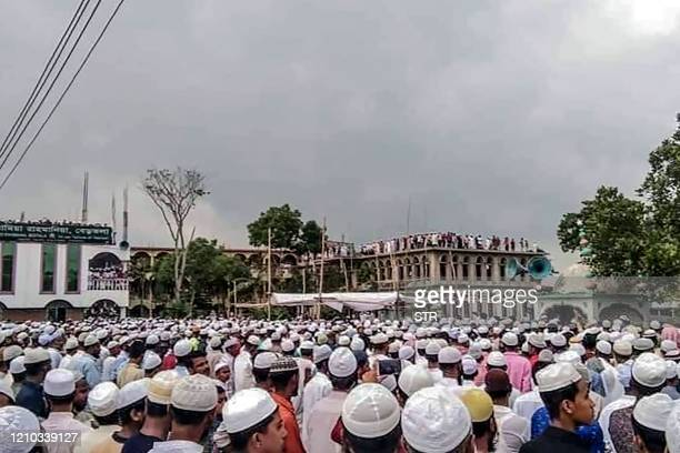 Muslim devotees attend a funeral prayer for an Islamic preacher during a government-imposed nationwide lockdown as a preventive measure against the...