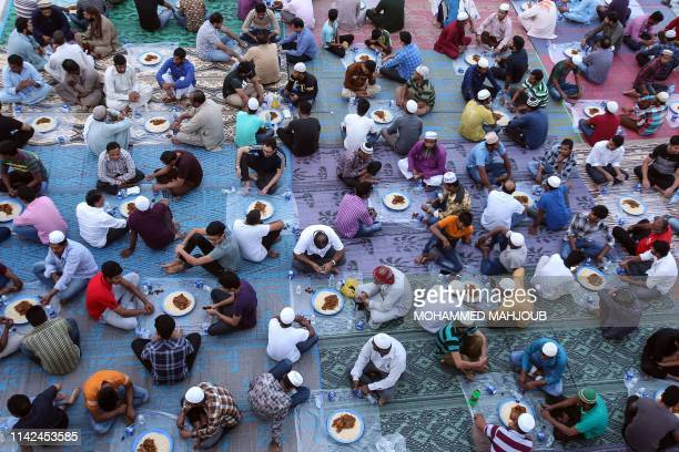 Muslim devotees break their fast during the holy month of Ramadan on May 09 2019 in the Omani capital Muscat