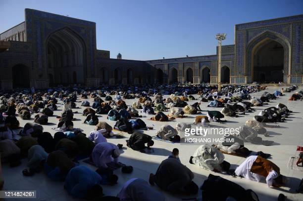 TOPSHOT Muslim devotees offer prayers at the start of the Eid alFitr festival which marks the end of the Muslim holy month of Ramadan at the Jami...
