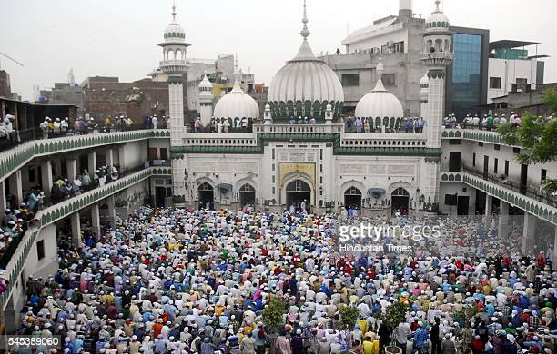 Muslim devotees offer prayers on Eid alFitr at historical mosque Khairudeen Hall Bazzar on July 7 2016 in Amritsar India The celebrations mark the...
