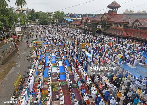 Muslim devotees offer prayers on the occasion of Eid alAdha outside Bandra Station on August 22 2018 in Mumbai India Eid alAdha marks the prophet's...