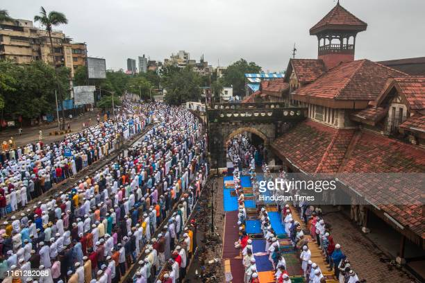 Muslim devotees offer prayers on the occasion of Eid al-Adha outside Bandra Station on August 12, 2019 in Mumbai, India. The holy festival of...