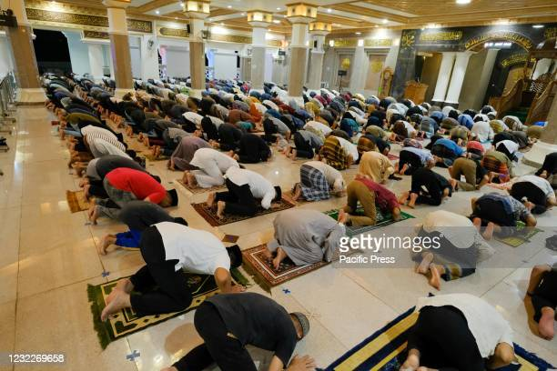Muslim devotees performing tarawih prayers to start the holy month of Ramadan while implementing health protocols at the Great Mosque of Darussalam,...