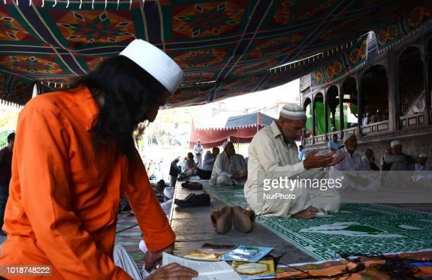 Muslim devotees pray at the shrine of Khaniqahi mullah during an annual festival in Srinagar the summer capital of Indian administered Kashmir India...