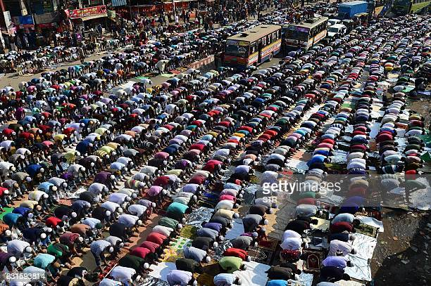 TOPSHOT Muslim devotees pray during the Friday noon prayers during the World Muslim Congregation also known as Biswa Ijtema at Tongi some 30 kms...