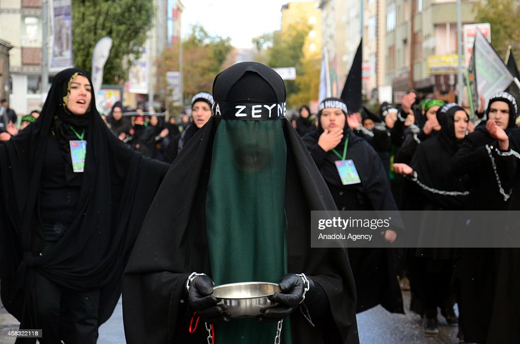 Muslim devotees take part in a morning procession marking the day of Ashura in Kars, Turkey on November 3, 2014. Shiite Muslims are observing the Ashura, the tenth day of the first Islamic month of Muharram, to commemorate the martyrdom of Imam Hussein, a grandson of the Prophet Mohammed, in the Iraqi city of Karbala in the seventh century.
