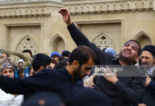 Muslim devotees take part in a mourning procession marking the day of Ashura in Baku Azerbaijan on October 1 2017 Muslims are observing the Ashura...