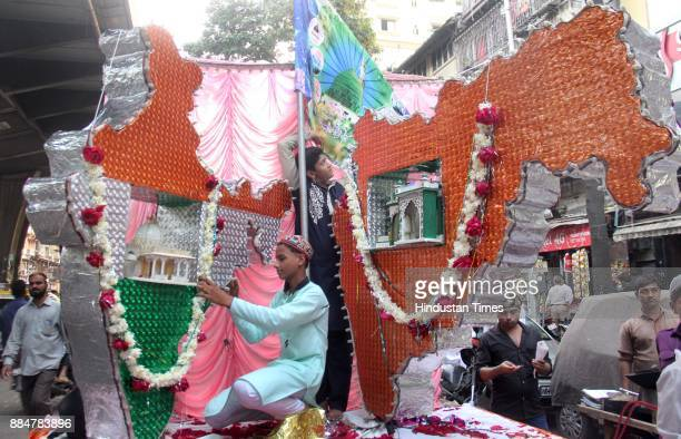 Muslim devotees take part in a procession during Eid MiladUnNabi the birth anniversary of Prophet Muhammad the founder of Islam also believed to be a...