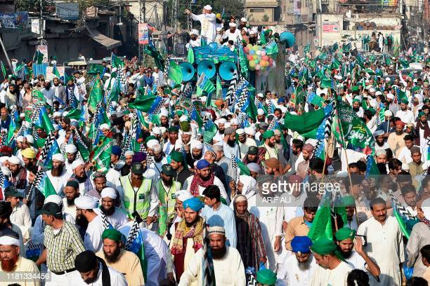 Muslim devotees take part of a procession to celebrate the birthday of Prophet Mohammed, in Lahore on November 10, 2019. - The birthday of Prophet...