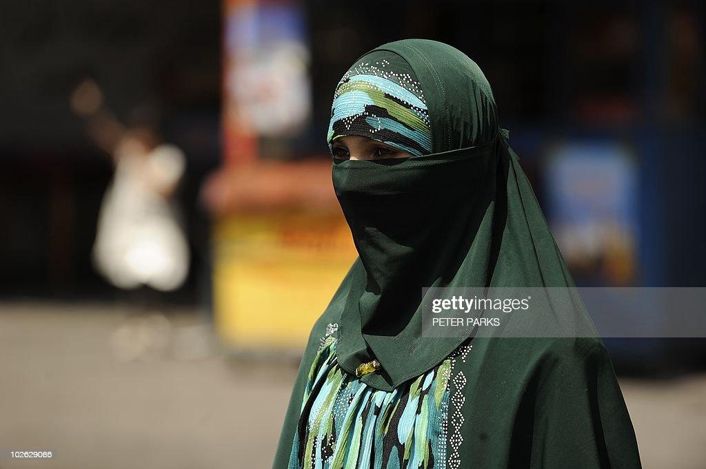 A Muslim ethnic Uighur woman walks on a : News Photo