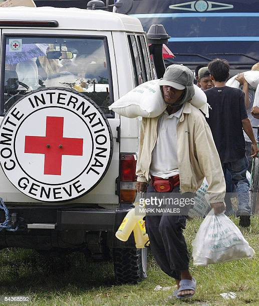 Muslim evacuees displaced by the fighting between government troops and Muslim separatist rebels in Datu Odin Sinsuat town in southern Philippine...