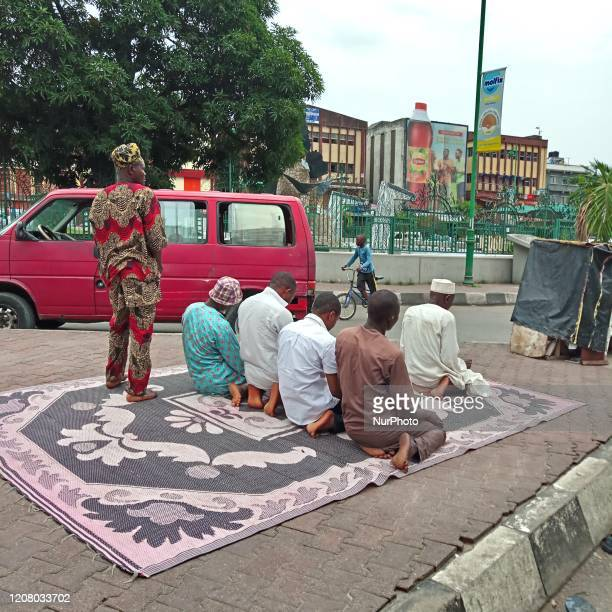 Muslim faithful pray at Tinubu Square in Lagos, Nigeria on March 22, 2020. In order to curtail the spread of coronavirus Lagos State has restricted...