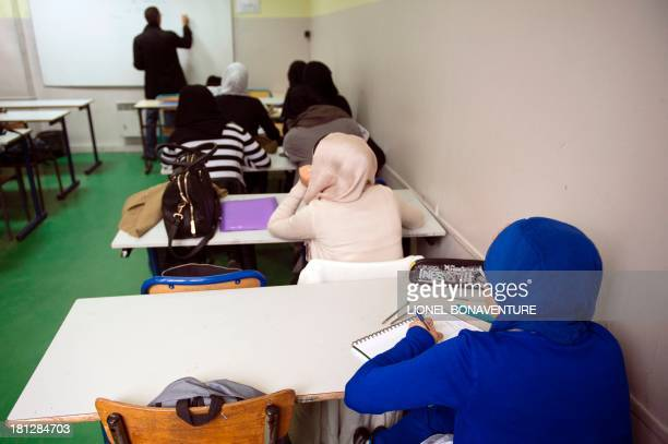 Muslim faithful students are pictured in their classroom at the La Reussite muslim school on September 19 2013 in Aubervilliers outside Paris AFP...