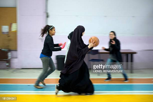 PLANTIVE Muslim faithful students play basketball at the La Reussite muslim school on September 19 2013 in Aubervilliers outside Paris AFP PHOTO /...