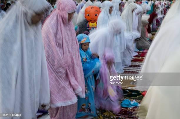 Muslim faithfuls attend a prayer as part of the Eid alAdha celebrations at the centuriesold Sunda Kelapa port in Jakarta on August 22 2018 Eid alAdha...