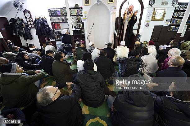 Muslim faithfuls attend Friday prayer in the Ali mosque in Paris on January 23 2015 AFP PHOTO / ERIC FEFERBERG