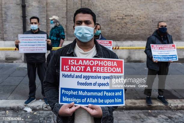 Muslim faithfuls hold placards during prayer organised by the Muslim community in the city centre near the French Embassy to protest against the...