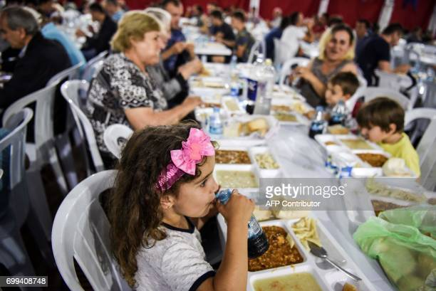 Muslim families break their fast with a free evening meal known as Iftar during the holy month of Ramadan in Pristina Kosovo on June 21 2017 During...