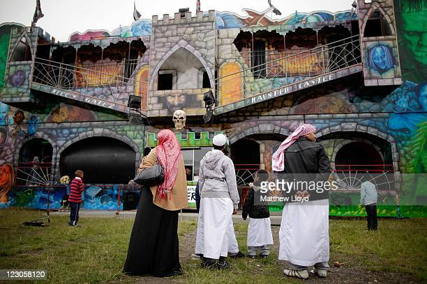 Muslim families celebrate Eid ulFitr with a visit to a fun fair on Wanstead Flats on August 30 2011 near Wanstead England With feasting gift giving...