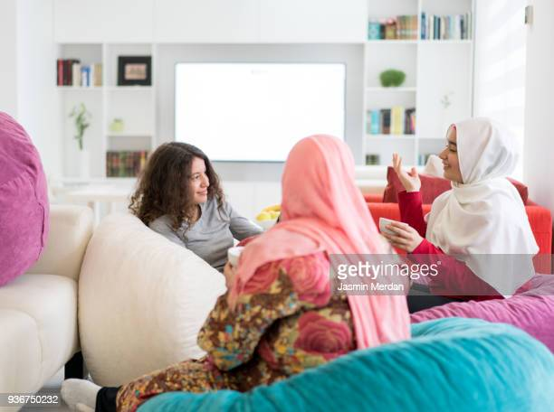muslim family at home - girls stock pictures, royalty-free photos & images