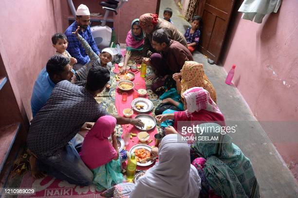 A Muslim family breaks their fast on the first day of the Islamic holy month of Ramadan at their home in Hyderabad on April 25 2020