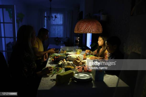 Muslim family eat fast-breaking dinner during the holy month Ramadan in east London, United Kingdom on May 07, 2020.