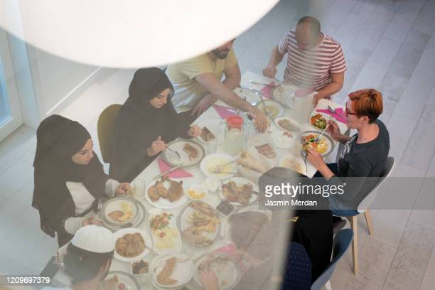 muslim family gathering for having iftar in ramadan together - fasting activity stock pictures, royalty-free photos & images