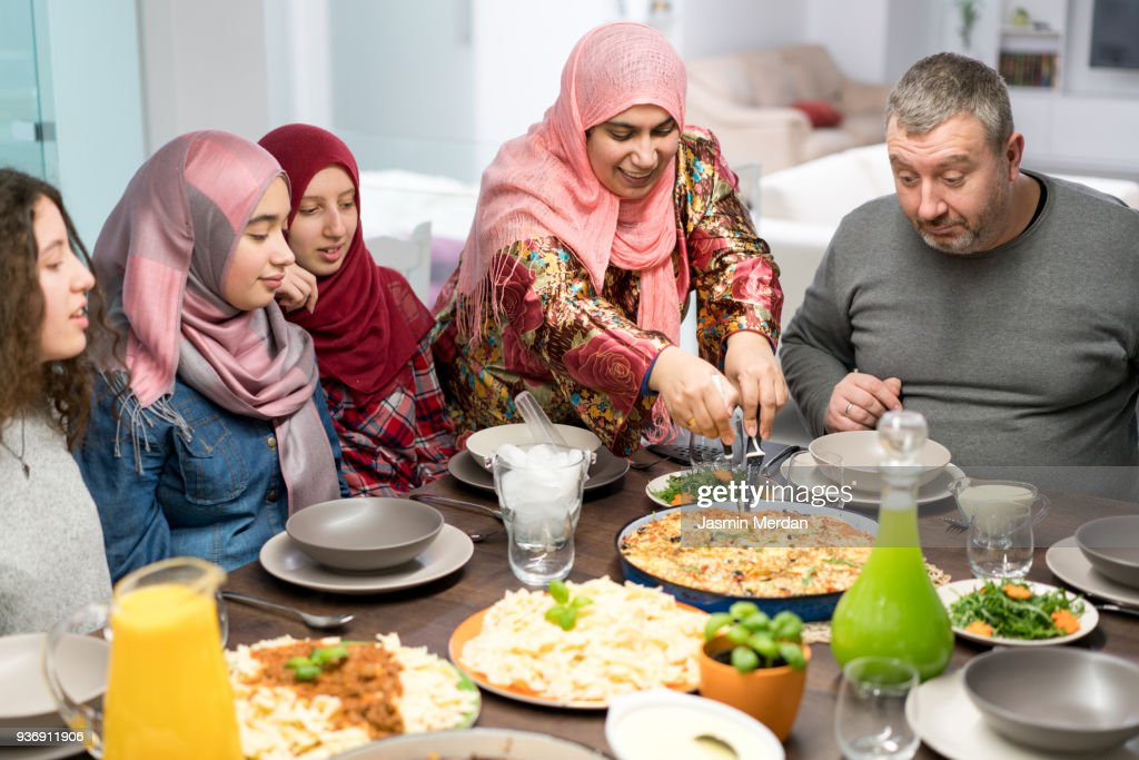 Muslim family gathering for Iftar food in Ramadan : Stock Photo
