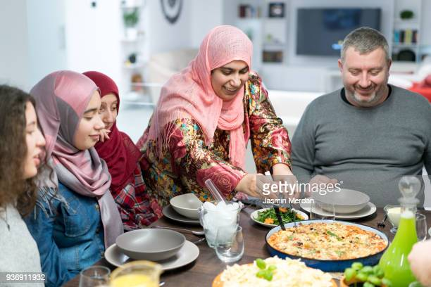 muslim family gathering for iftar food in ramadan - ramadan stock pictures, royalty-free photos & images